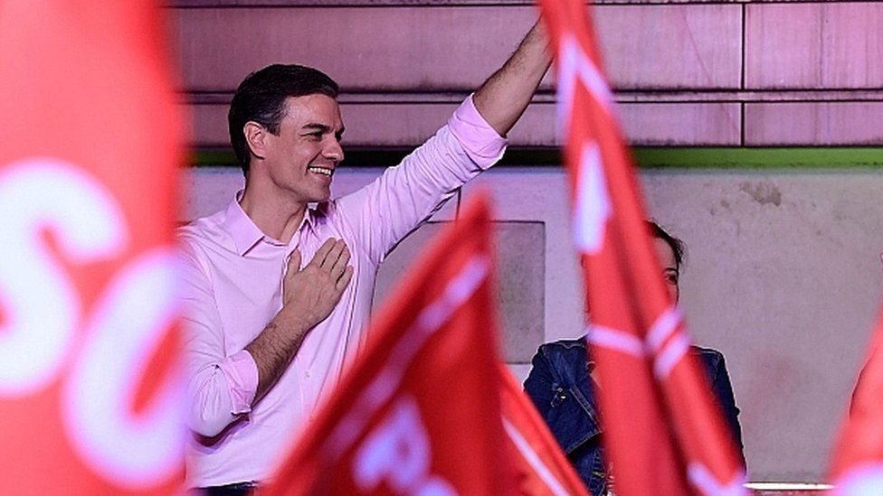 Spanish PM Pedro Sanchez waves during an election night rally in Madrid after general elections on April 28, 2019