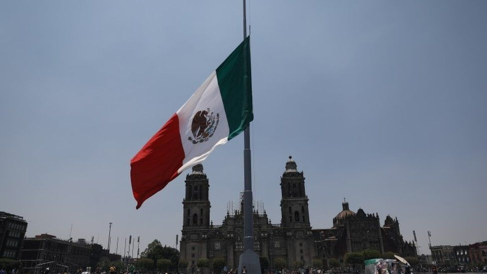 Mexican flag at half mast