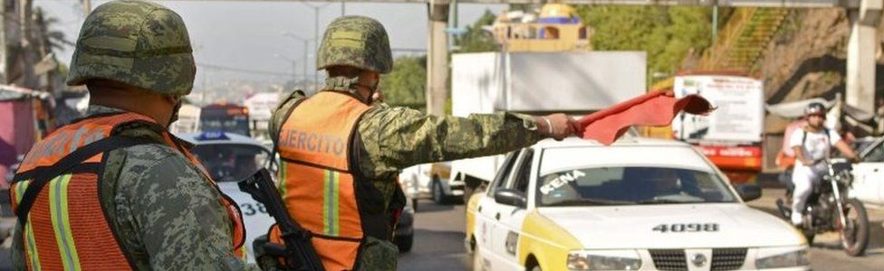 Soldiers from the Mexican Army stop drivers at a checkpoint on the Acapulco-Mexico City highway on December 5, 2017 in Acapulco, Guerrero state, Mexico.