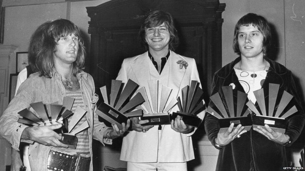 Keith Emerson (left), Greg Lake (centre) and Carl Palmer - Emerson Lake And Palmer - receive awards at the 1972 Melody Maker Pop Poll