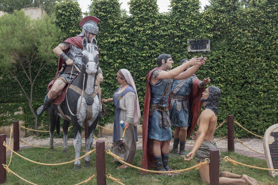 A statue showing Roman soldiers putting the crown of thorns on Jesus