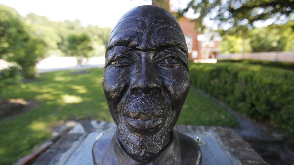 A statue of Cudjoe Lewis, the last surviving person brought over on the slave ship Clotilda