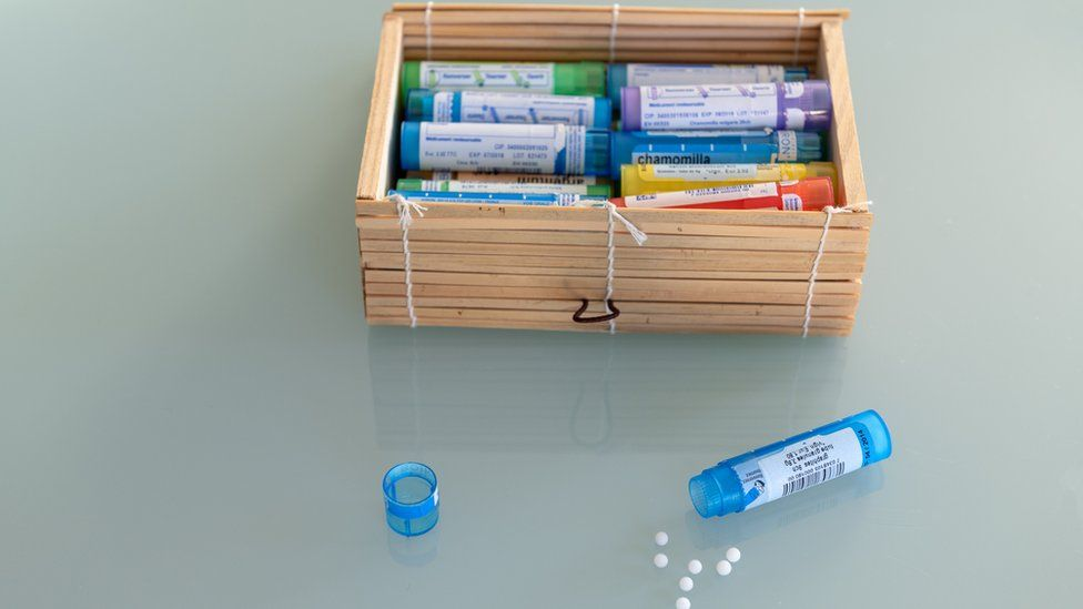 Homeopathy globules in coloured containers