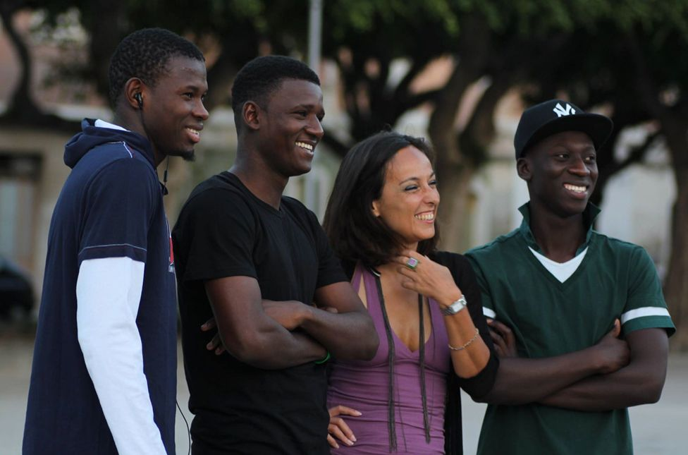 Barbara Sidoti with Yahya (second from left) and two other boys she mentored