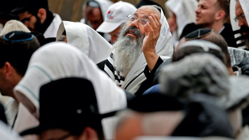 "Jewish priests wearing ""Talit"" prayer shawls take part in the Cohanim prayer (priest's blessing) during the Passover (Pesach) holiday at the Western Wall in the Old City of Jerusalem."