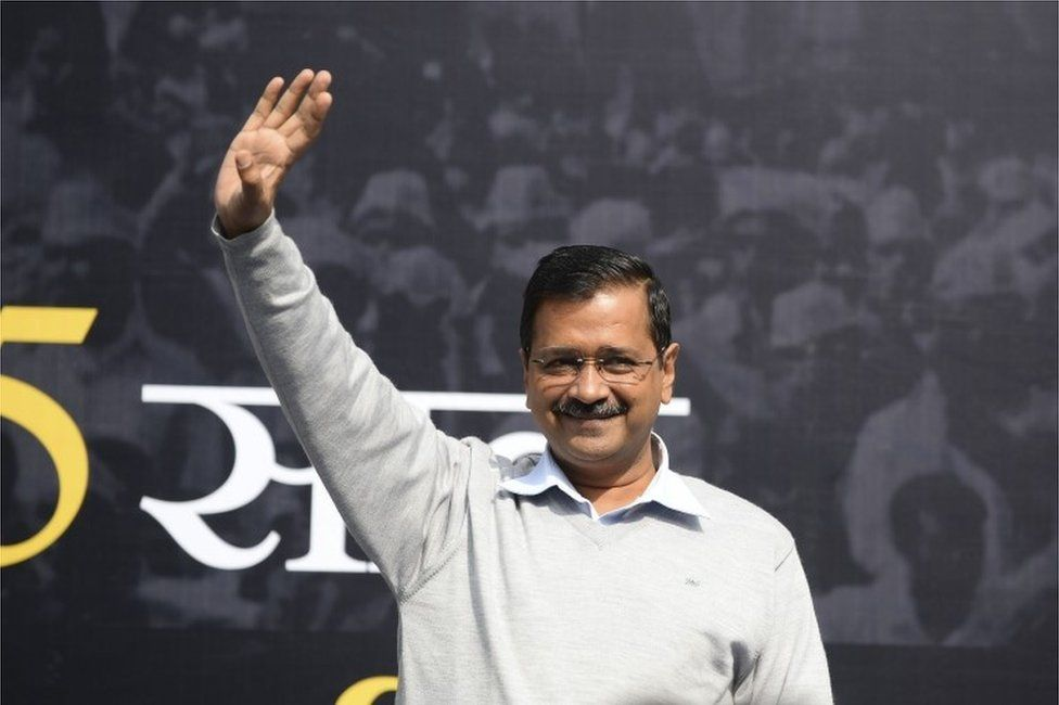 """Delhi Chief Minister Arvind Kejriwal and leader of India""""s Aam Admi Party (AAP) gestures before releasing the """"Kejriwal Ka Guarantee Card"""" promising improvements on electricity, drinking water and women safety, ahead of Delhi Assembly Elections 2020, in New Delhi on January 19, 2020"""