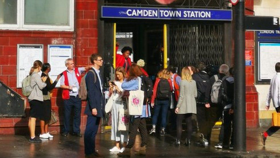 Commuters queue outside Camden station