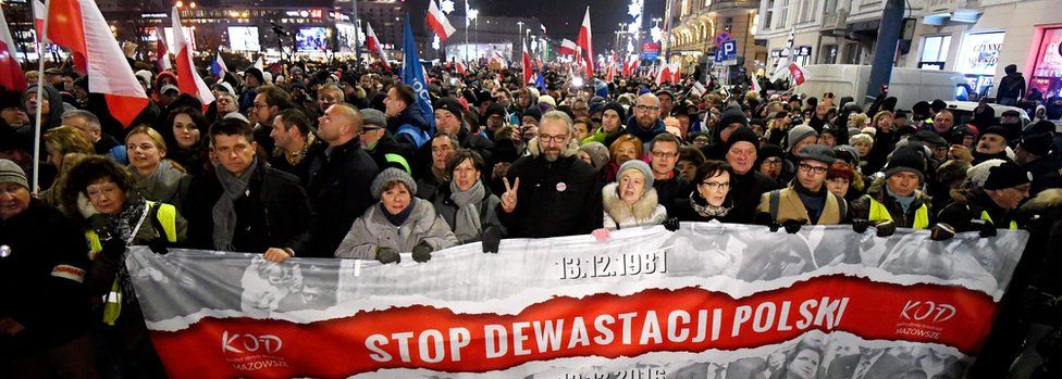 "Former Polish PM Ewa Kopacz (4-R), the Committee for the Defence of Democracy (KOD) leader Mateusz Kijowski (6-R) and leader of Polish Nowoczesna Party Ryszard Petru (3-L) with other demonstrators take part in the ""Stop Devastation of Poland"" march"