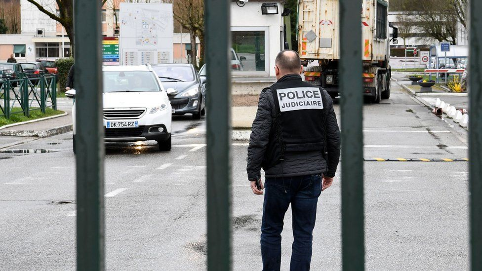 Police stand guard at entrance to 7th CBA de Reynies barracks