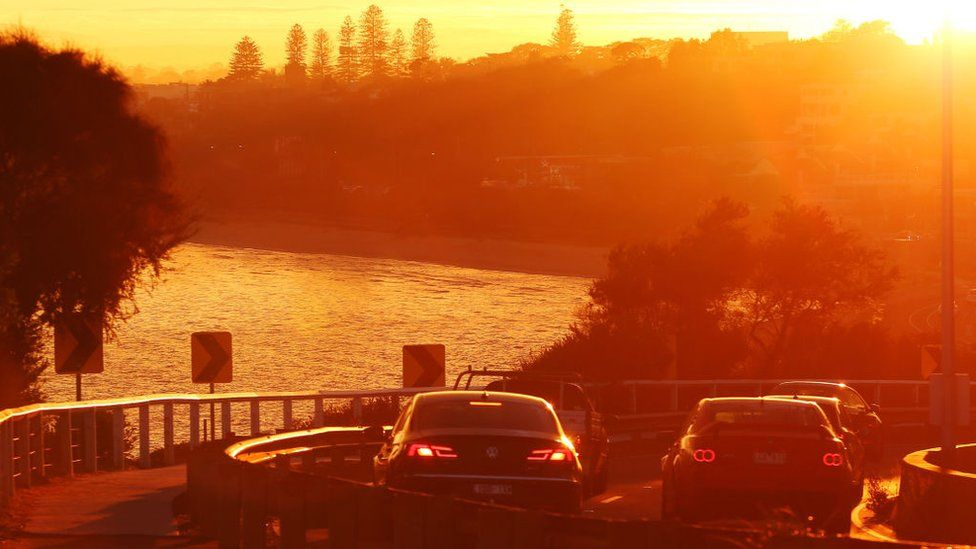 Peak hour traffic in Melbourne as the morning fog makes way for sunrise
