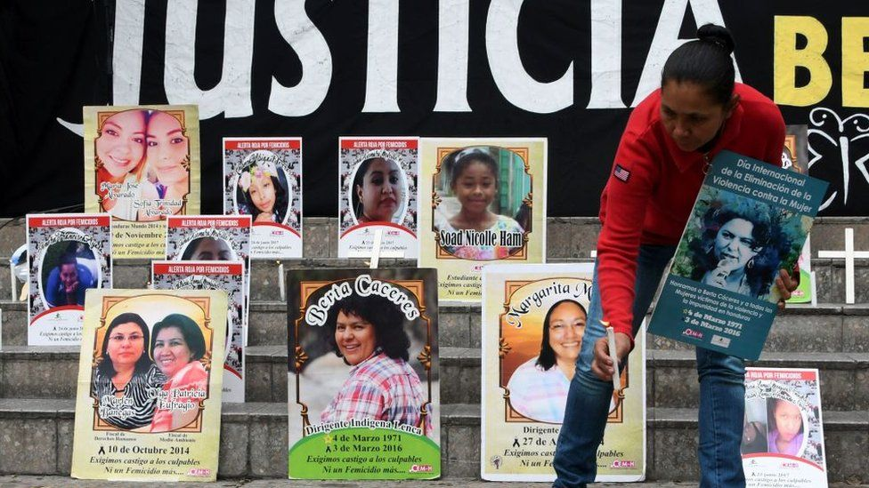 Pictures of women who have been killed, including well-known environmental activist Berta Caceres (centre)