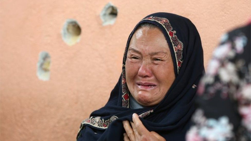 An Afghan woman cries while looking for her relative at a hospital which came under attack yesterday in Kabul, Afghanistan May 13, 2020.
