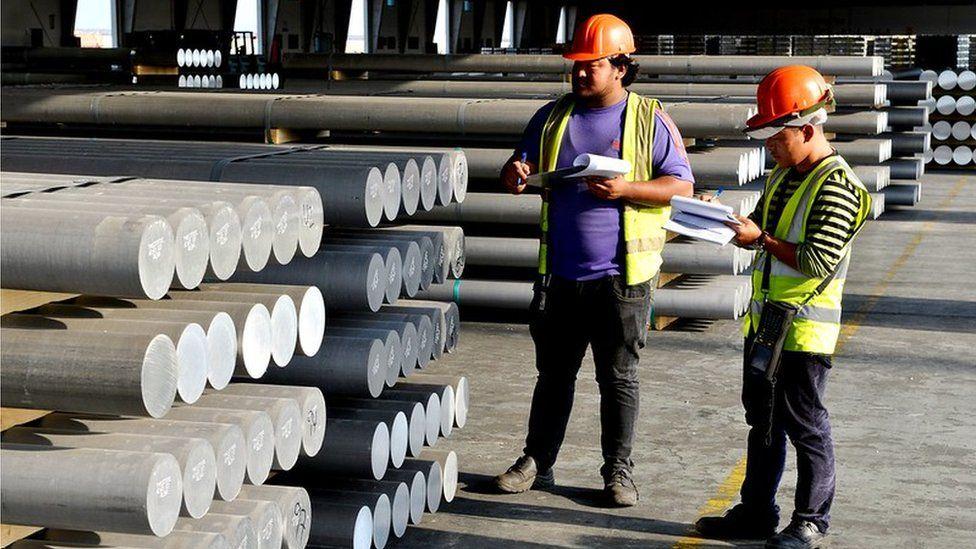 Workers Khalifa Bin Salman Port
