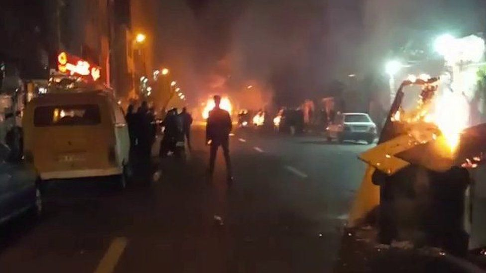 Nighttime photo shows fires in a Tehran street