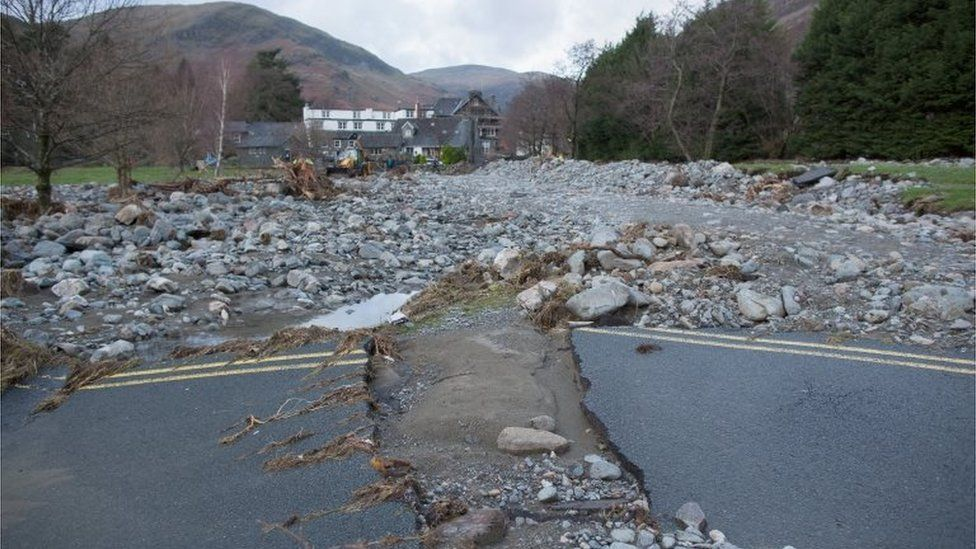 Rubble and stones are left on the shoreline of Ullswater Llake next to the village of Glenridding after flash floods in Penrith, 10 December 2015
