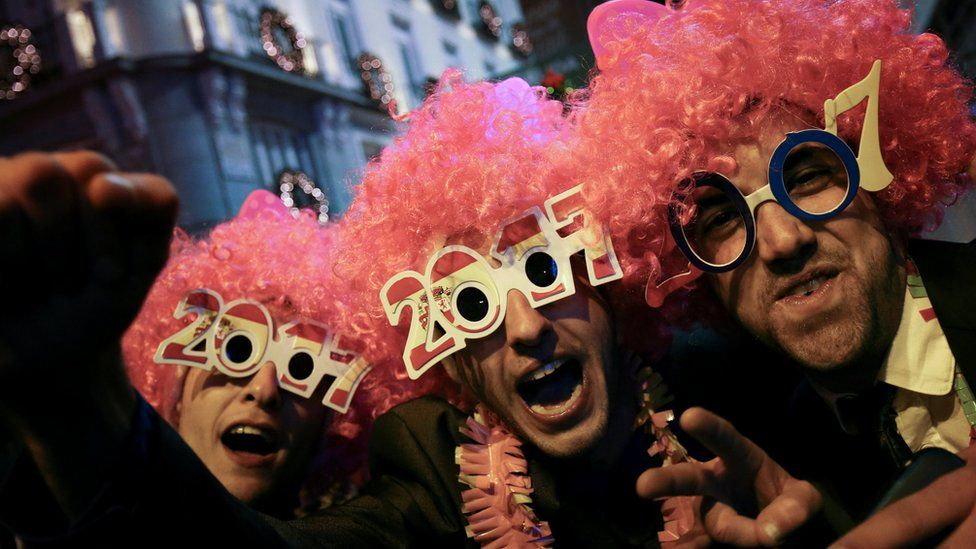 """Revellers take part in New Year""""s celebrations at Puerta del Sol square in central Madrid, Spain"""