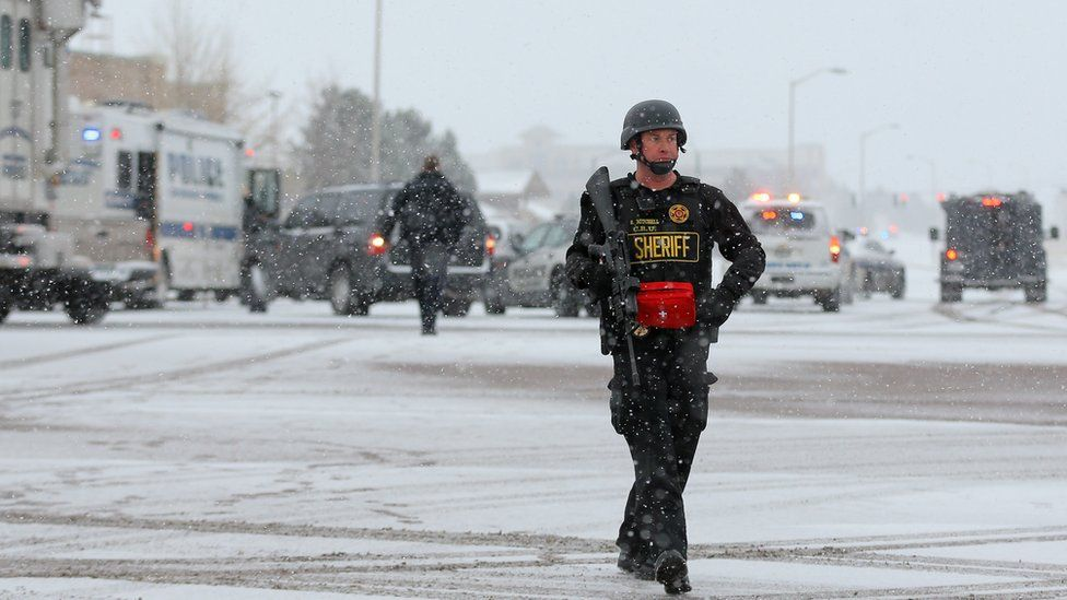 Armed police secure the scene outside a Planned Parenthood facility in Colorado Springs. 27 Nov 2015