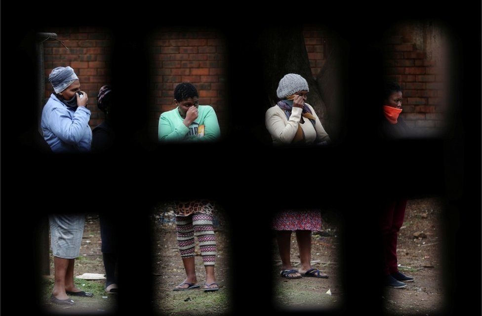 Women queue ahead of food distribution in Alexandra township on 28 April 28.