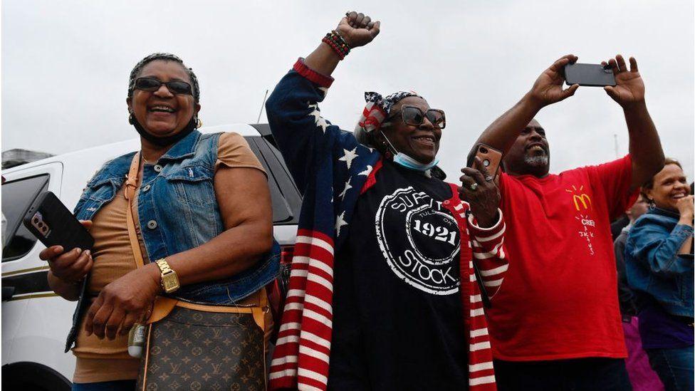 People cheer as Biden arrives in Greenwood