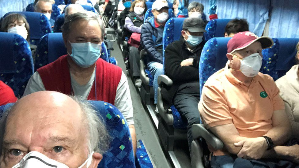 U.S. passengers on board the Diamond Princess cruise ship, who have chosen to leave, are transported by shuttle bus in Yokohama to Haneda airport to fly back to the United States via chartered evacuation aircraft,