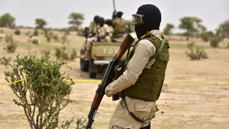 Niger Army armed forces patrol during a visit of Niger's Interior Minister to a refugee camp near Diffa on June 16, 2016 following attacks by Boko Haram fighters in the region.