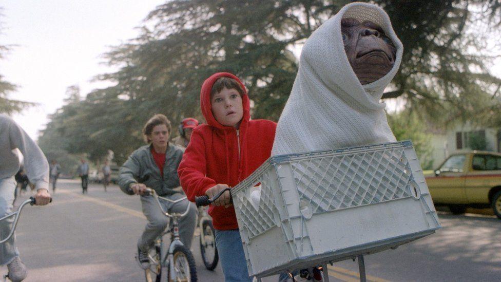 Elliott and E.T. on a bike in the 1982 blockbuster film