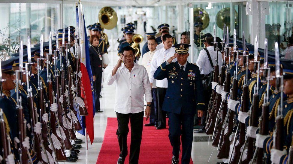 Philippine President Rodrigo Duterte reviews honour guards during a departure ceremony at the Manila International Airport, Philippines, 13 December 2016.