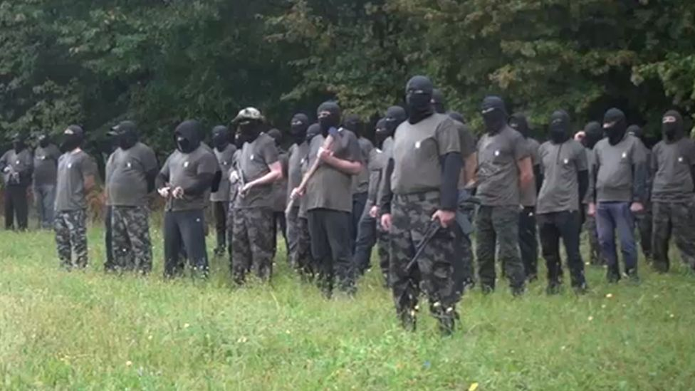 Militants pose in field