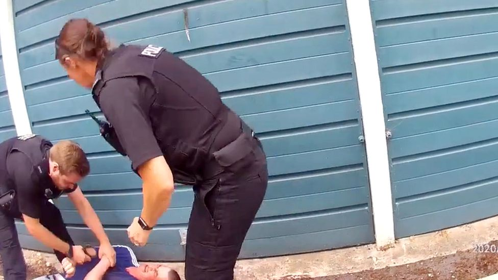 Police arresting David Wilkie
