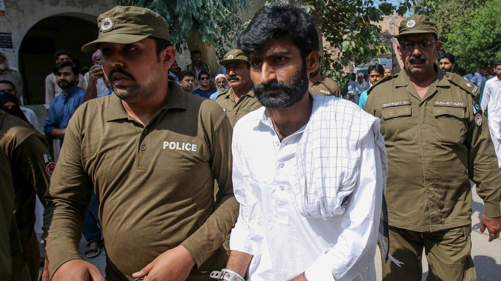 Policemen escort hand-cuffed Muhammad Waseem (C), the brother of slain social media celebrity Qandeel Baloch, as he leaves the court after the verdict in Multan on September 27, 2019