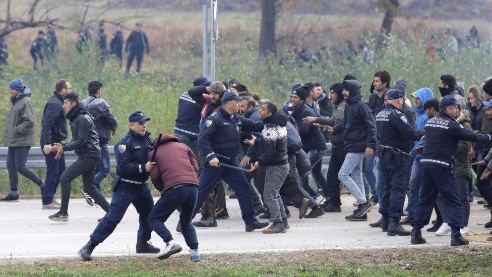Migrants are stopped by the Bosnian police 200 metres from the border