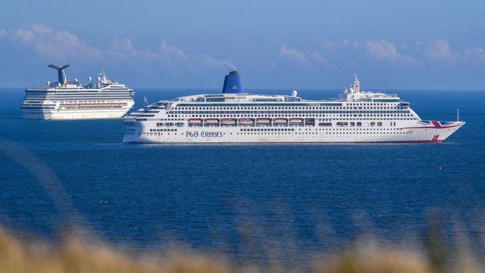 Cruise ships anchored off the coast of Dorset