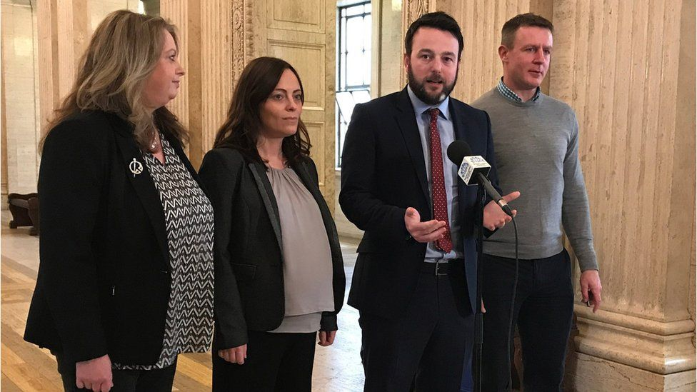 SDLP leader Colum Eastwood (second right) speaking to the media at Stormont