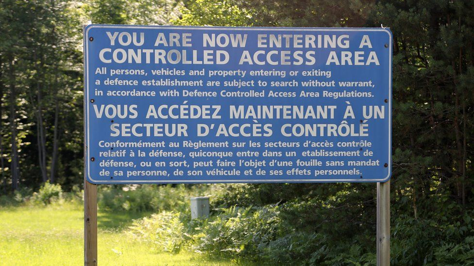 """A large sign on the grounds of a Borden base warns that """"you are now entering a controlled access area"""""""