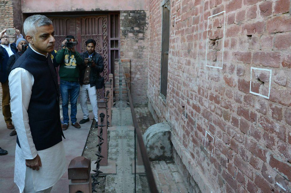 London mayor Sadiq Khan looks at the bullet marks on a wall during his visit to Jallianwala Bagh in Amritsar