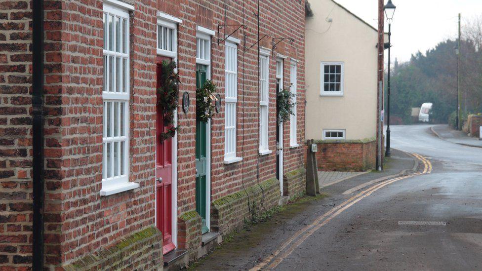 Christmas wreaths on doors in Fishlake