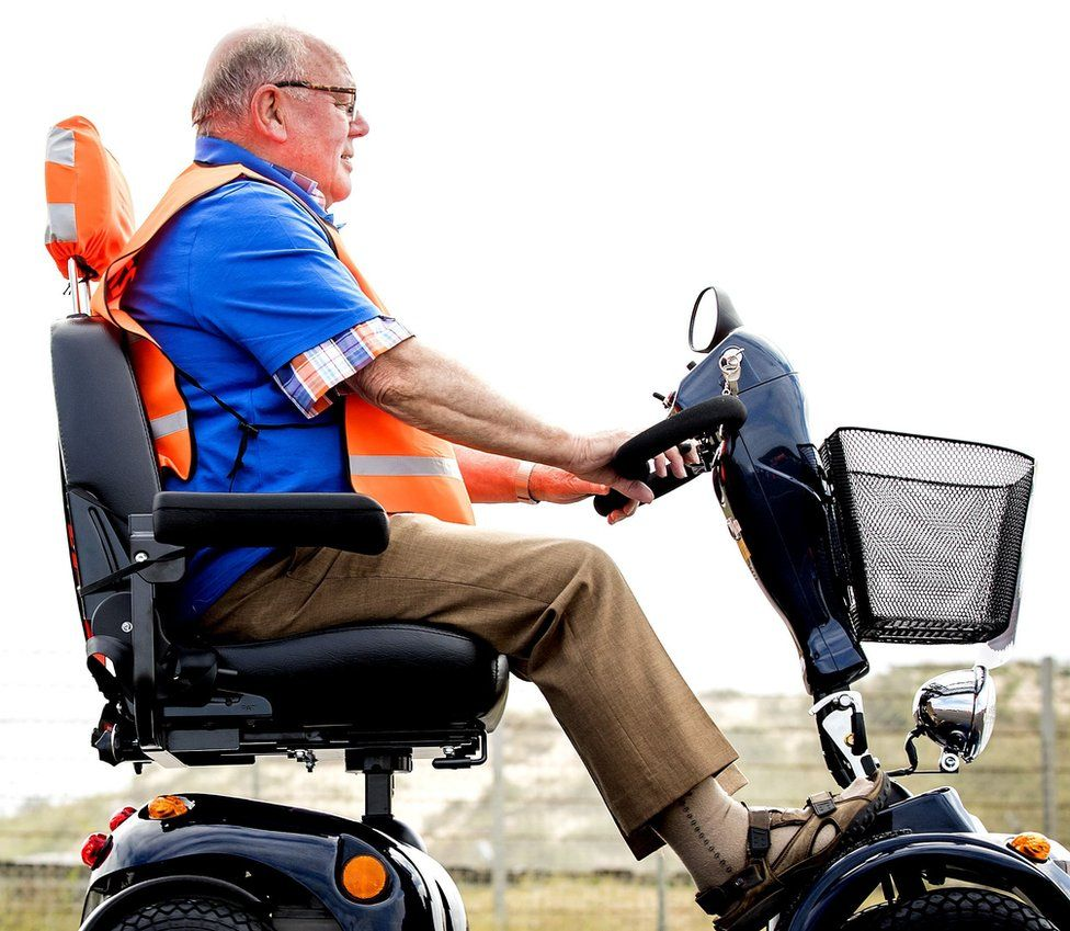 Man using a mobility scooter