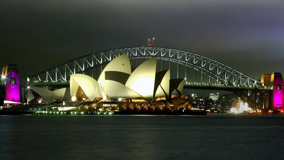 A view of the Sydney Opera House and Bridge at night