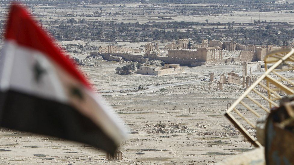 Syrian flag with Palmyra in background - 1 April