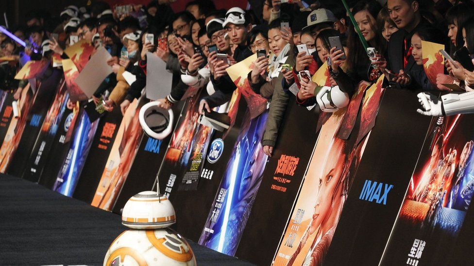 """Chinese fans take pictures of the droid character BB-8 at the Shanghai premiere of """"Star Wars: The Force Awakens"""""""