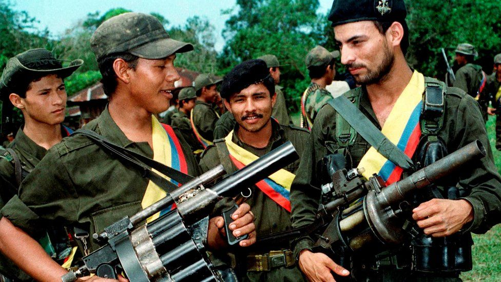 Guerrilla fighters the Revolutionary Armed Forces of Colombia (FARC) pose with their weapons after a patrol in the jungle near the town of Miraflores, Colombia, August 7, 1998