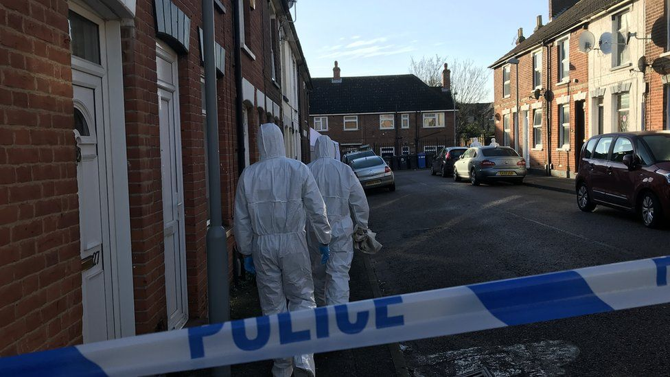 Forensic officers at the scene of the stabbing