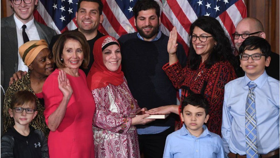 US House Representative Rashida Tlaib (D-MI) participates in a ceremonial swearing-in from Speaker of the House Nancy Pelosi (D-CA) at the start of the 116th Congress at the US Capitol in Washington, DC, January 3, 2019