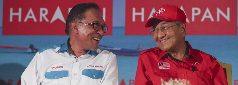 Next the prime minister in waiting Anwar Ibrahim (L) have a chat with Malaysia Prime Minister Mahathir Mohamad (R) during a campaign ahead of by election in Port Dickson