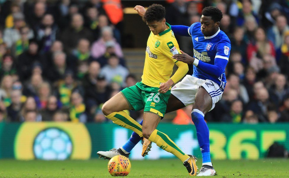 Jamal Lewis of Norwich City and Dominic Iorfa of Ipswich Town