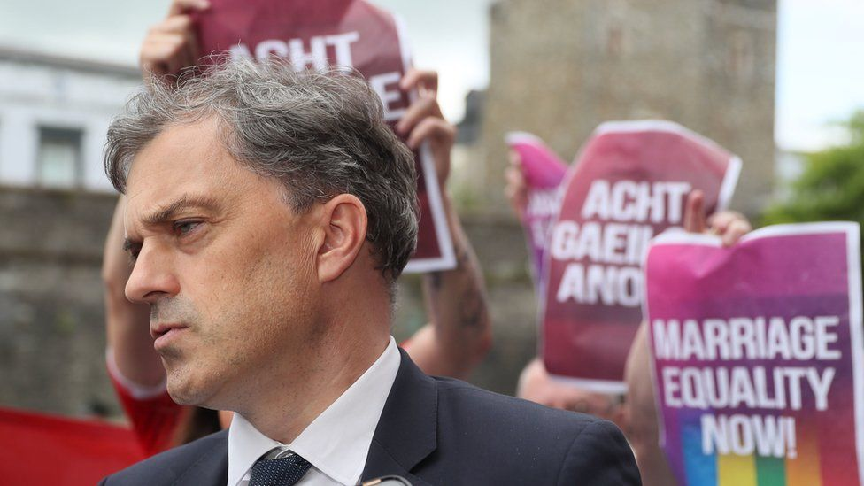 Julian Smith met by protesters at the Guild Hall