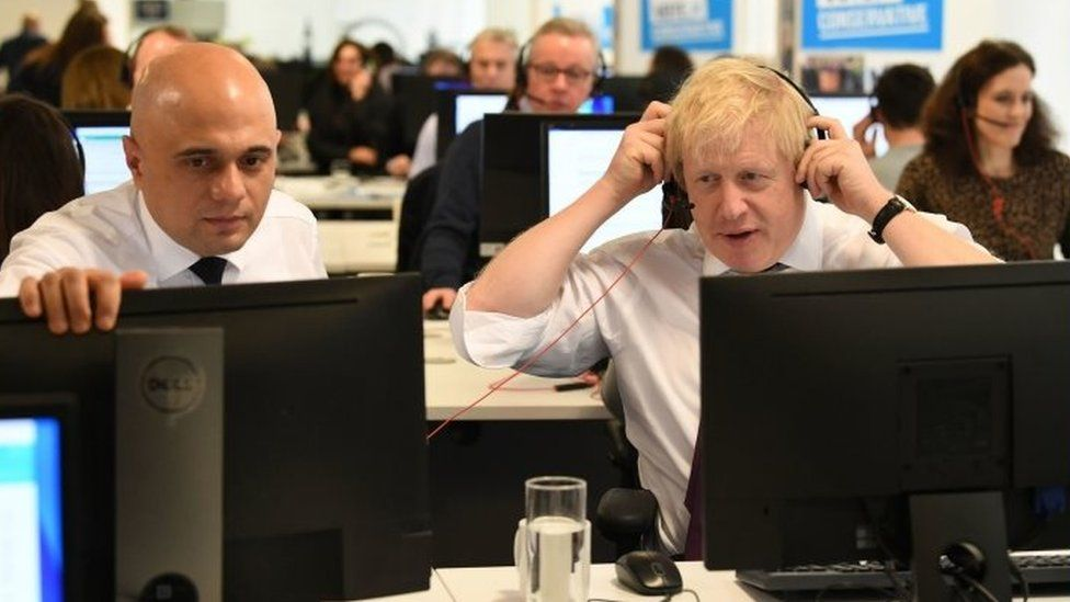 Sajid Javid and Boris Johnson at a call centre