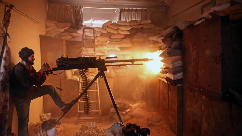 AN opposition fighter from the Faylaq al-Rahman brigade fires a heavy machine gun in Jobar, a rebel-held district on the eastern outskirts of the Syrian capital Damascus, on March 19, 2017