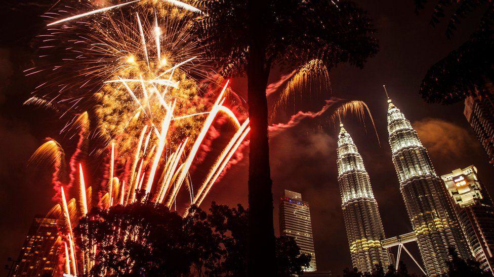Fireworks illuminate the night sky over Malaysia's landmark, Petronas Towers during New Year's Eve celebrations in Kuala Lumpur, Malaysia