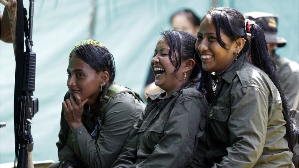 In this Aug. 16, 2016 photo, rebels of the 32nd Front of the Revolutionary Armed Forces of Colombia, or FARC, laugh during a break, at their camp in the southern jungles of Putumayo, Colombia. As Colombia€™s half-century conflict winds down, with the signing of a peace deal perhaps just days away, thousands of FARC rebels are emerging from their hideouts and preparing for a life without arms.
